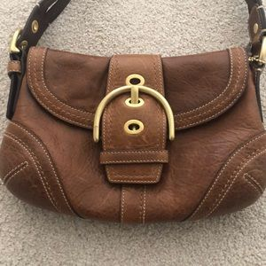 Coach leather purse with braided shoulder strap